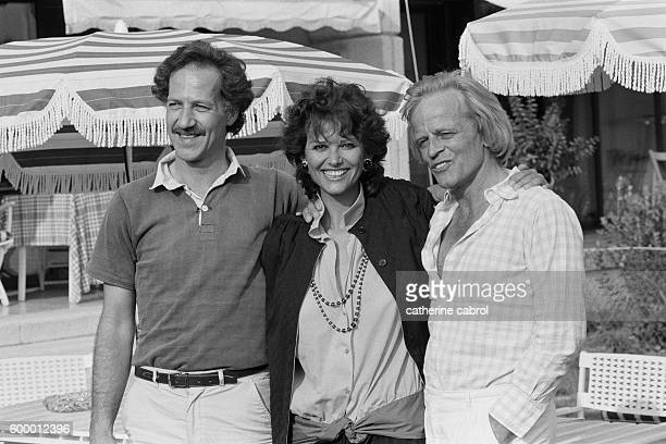 German director Werner Herzog, Italian actress Claudia Cardinale and German actor Klaus Kinski attend the 35th Cannes Film Festival for the presentation of Herzog's movie Fitzcarraldo.