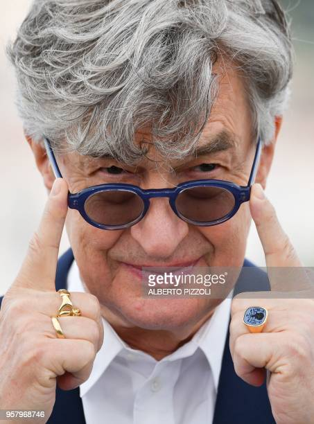 German director Wim Wenders poses on May 13 2018 during a photocall for the film 'Pope Francis A Man of His Word' at the 71st edition of the Cannes...