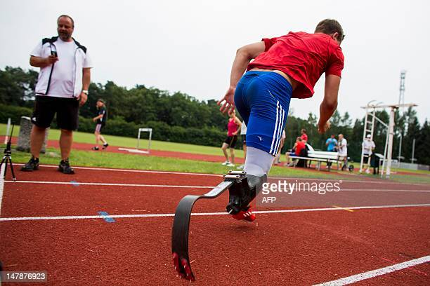 German disabled sprinter Nick Weihs runs at the National Olympic Trainings Center Kienbaum in Gruenheide, eastern Germany on July 05, 2012 ahead of...