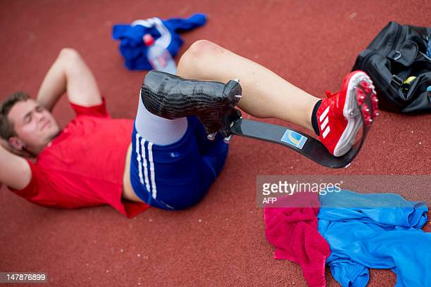 German disabled sprinter Nick Weihs warms up at the National Olympic Trainings Center Kienbaum in Gruenheide, eastern Germany on July 05, 2012 ahead...