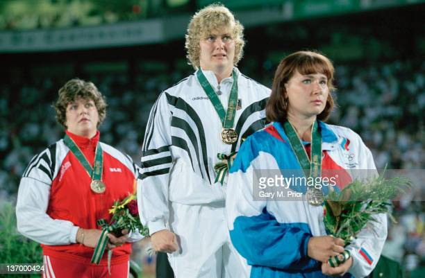 German discus thrower Ilke Wyludda wins the gold medal at the Olympic Stadium during the Olympic Games at Atlanta Georgia 29th July 1996 WIth her are...