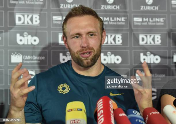 German discus thrower Robert Harting speaks during a press conference announcing his withdrawal from the upcoming World Championships in Athletics...