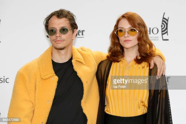 German DJ Frans Zimmer of Alle Farben and his girlfriend arrive for the Echo Award at Messe Berlin on April 12 2018 in Berlin Germany