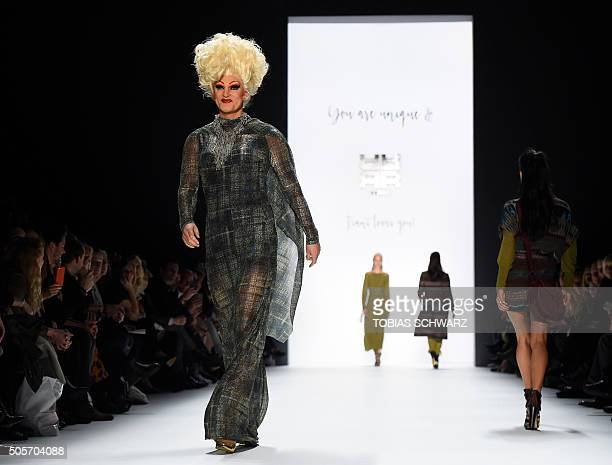 German drag queen Olivia Jones presents a creation by Riani at the Berlin Fashion week on January 19 2016 / AFP / afp / TOBIAS SCHWARZ / RESTRICTED...
