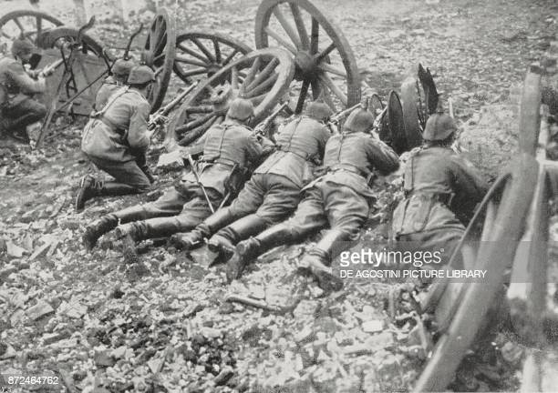 German Dragon patrol defending an attack behind an improvised trench with cart wheels France World War I from L'Illustrazione Italiana Year XLII No...