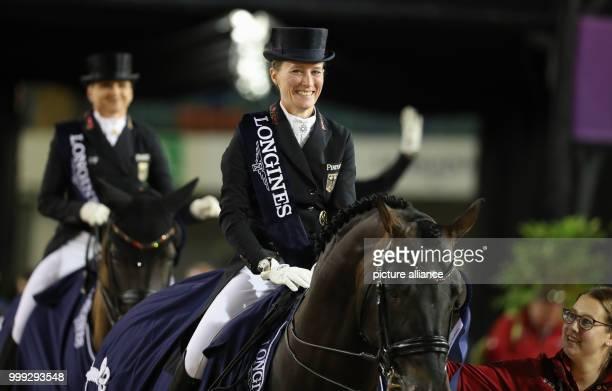 German dressage rider Helen Langehanenberg smiles after winning the gold medal in the team dressage event of the FEI European Championships 2017 in...