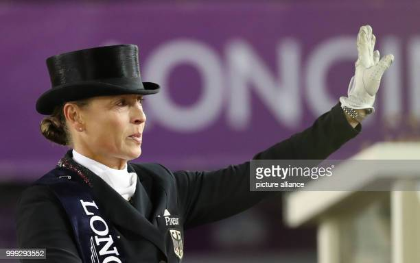 German dressage rider Isabell Werth waves after winning the gold medal in the team dressage event of the FEI European Championships 2017 in Goteborg,...