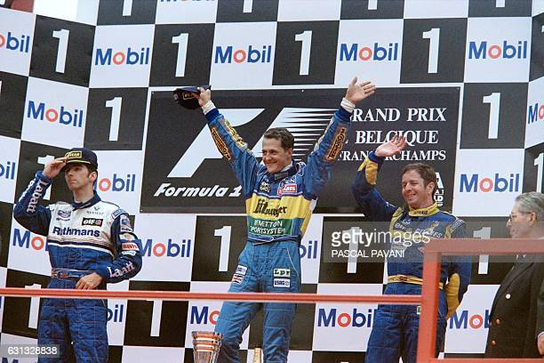 German driver Michael Schumacher , British drivers Damon Hill and Martin Brundle celebrate on the podium after winning the Belgium Formula One Grand...