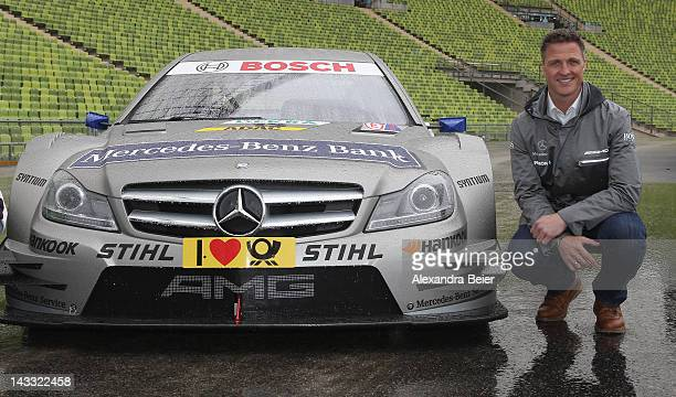German DTM driver Ralf Schumacher poses for photographers next to his DTM German touring car of Mercedes Benz on April 24, 2012 in Munich, Germany.