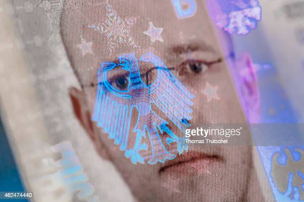 German eagle symbol as a hologram on the biometric passport photo on a German identity card on January 20 2015 in Berlin Germany
