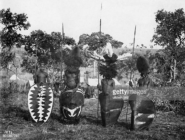 German East Africa Massai warriors with headdress and lances probably in the 1910s