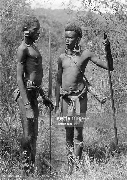 German East Africa native warriors with prolonged earlobes caused by earrings from wood or metal probably in the 1910s