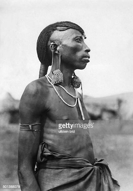 German East Africa portrait of a native of the Maasai people his earlobes prolonged by earrings probably in the 1910s