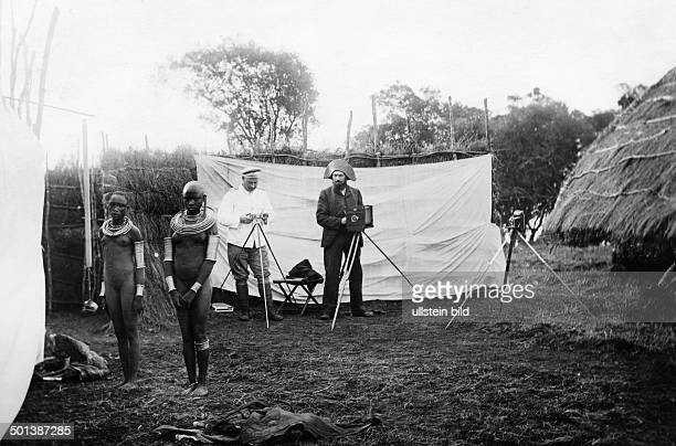 German East Africa white men take a photo of Massai girls 1910