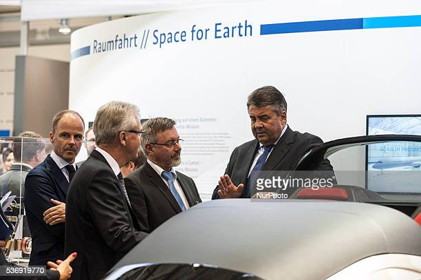 German Economics Minister Sigmar Gabriel visting the stand of DLR at opening tour of the ILA Berlin Air Show in Berlin Germany 01 June 2016 The...