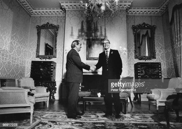 German economist Karl Otto Pohl President of the Deutsche Bundesbank meets John Major the British Chancellor of the Exchequer in the State Drawing...