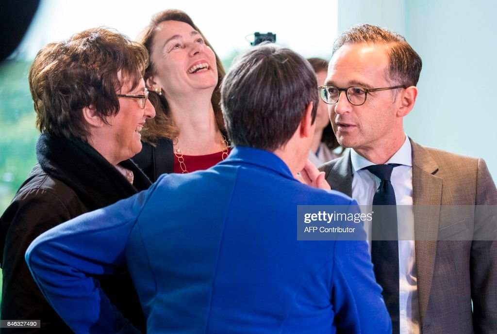 German Economy and Energy Minister Brigitte Zypries, German Family Minister Katarina Barley, German Environment Minister Barbara Hendricks and German Justice Minister Heiko Maas share a light moment prior to the weekly cabinet meeting at the Chancellery in Berlin on September 13, 2017. / AFP PHOTO / Odd ANDERSEN