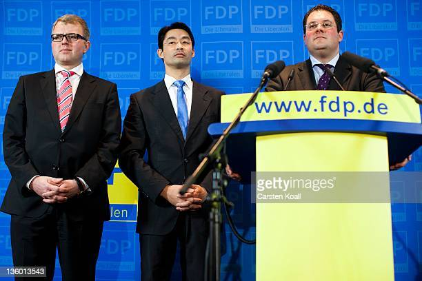 German Economy Minister and Chairman of the German Free Democrats political party Philipp Roesler Secretary General designate Patrick Doering and...