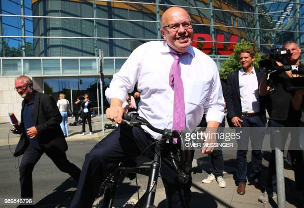 German Economy Minister and Christian Democratic Union politician Peter Altmaier leaves on his bicycle after a party leadership meeting at the CDU...