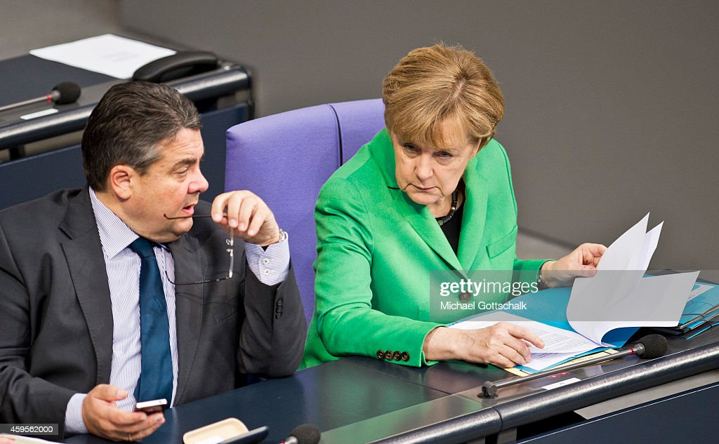 German Economy Minister and Vice Chancellor Sigmar Gabriel and German Chancellor Angela Merkel attend the budget debate in German Bundestag on November 25, 2014 in Berlin, Germany. German Finance Minister Wolfgang Schaeuble wants EU to have budget veto powers over national budgets that breach Eurozone criteria.