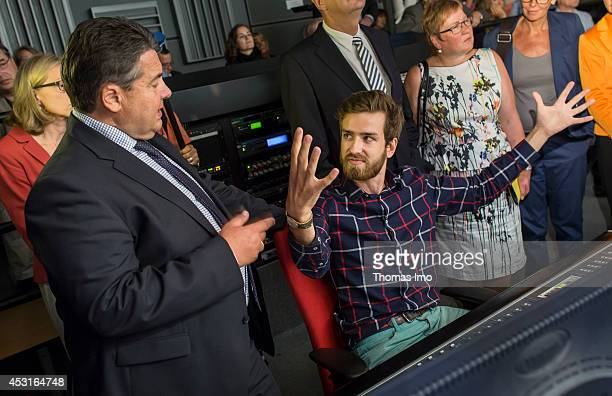 German Economy Minister and Vice Chancellor Sigmar Gabriel chats with a student in the recording studio of Babelsberg University for Film during his...