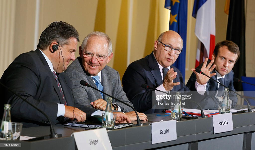 German Economy Minister and Vice Chancellor Sigmar Gabriel, German Finance Minister Wolfgang Schaeuble, French Finance Minister Michel Sapin, and French Economy and Industry Minister Emmanuel Macron, speaks to the media after their meeting on October 20, 2014 in Berlin, Germany. The Ministers discussed the economic and financial cooperation policy between Germany and France.