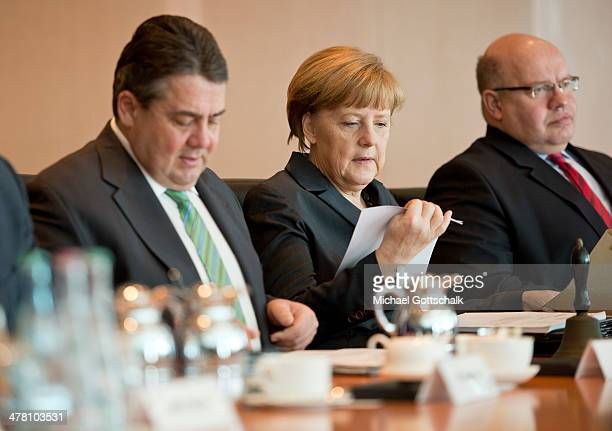 German Economy Minister and Vice Chancellor Sigmar Gabriel German Chancellor Angela Merkel and Head of the German Chancellery Peter Altmaier attend...