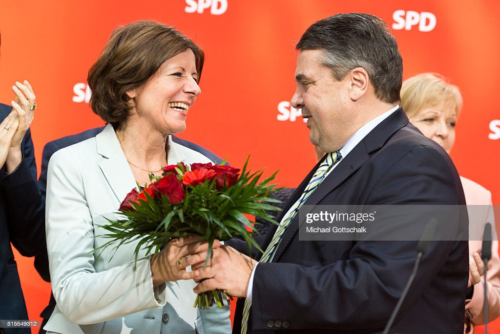 German Economy Minister and Vice Chancellor Sigmar Gabriel congratulates Manu Dreyer, Prime Minister of German State of Rhineland-Palatinate, German Economy Minister and Vice Chancellor Sigmar Gabriel, prior party board meeting on March 14, 2016 in Berlin, Germany. Voters went to the polls yesterday in Rhineland-Palatinate, Saxony-Anhalt and Baden-Wuerttemberg and the right-leaning populist Alternative fuer Deutschland (Alternative for Germany,AfD) scored double-digit results in all three, rocking Germany's established parties. The SPD, though it won in Rhineland-Palatinate, suffered major defeats in the other two states. AfD voters also dealt a blow to the German Christian Democrats (CDU) of Chancellor Angela Merkel. Her liberal immigration policy towards migrants and refugees was a major issue in the elections and the AfD aimed its campaign at Germans who are uneasy with so many newcomers.