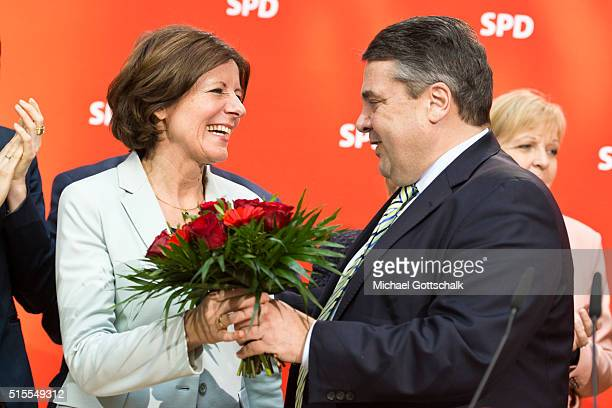 German Economy Minister and Vice Chancellor Sigmar Gabriel congratulates Manu Dreyer, Prime Minister of German State of Rhineland-Palatinate, German...