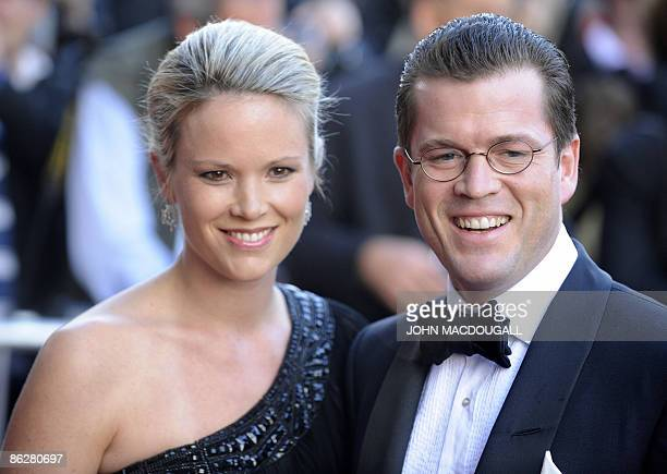 German Economy Minister KarlTheodor zu Guttenberg arrives with his wife Stephanie at the German Historical Museum where Britain's Prince Charles is...