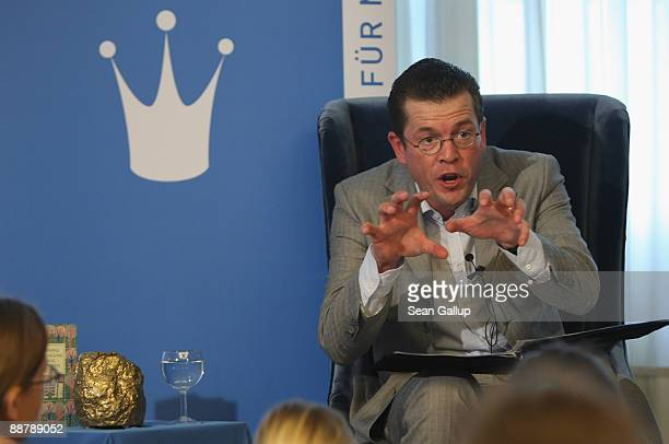 German Economy Minister KarlTheodor zu Guttenberg reads the fairy tale Hans In Luck to children at Max Liebermann Haus on July 2 2009 in Berlin...