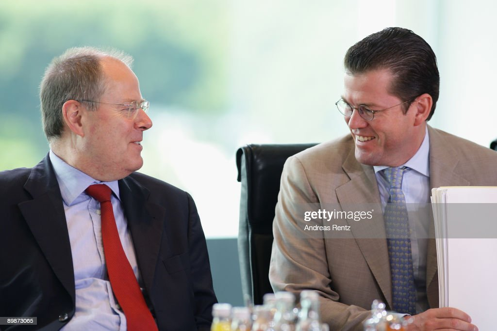 German Economy Minister Karl-Theodor zu Guttenberg (R) talks with German Finance Minister Peer Steinbrueck prior to the weekly German government cabinet meeting at the Chancellery on August 19, 2009 in Berlin, Germany. High on the morning's agenda was the obligation of the statutory health insurance of the new vaccinations against influenza A(H1N1), so called swine flu.