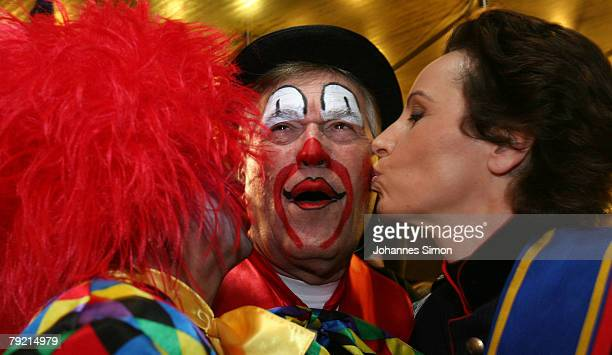 German Economy Minister Michael Glos is kissed by General Secretary of the Christian Social Union Christine Hadethauer and his wife Ilse prior to the...