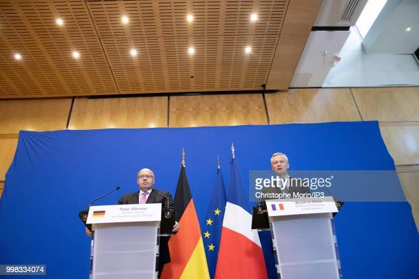 German Economy Minister Peter Altmaier and French Minister of economy Bruno Le Maire speak during a joint press conference on July 11 2018 in Paris...