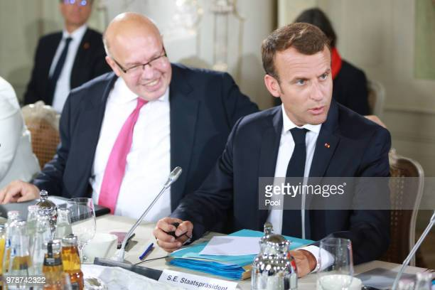 German Economy Minister Peter Altmaier and French President Emmanuel Macron attend the 20th GermanFranco Ministerial Council at Schloss Meseberg on...