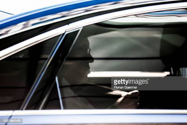 German Economy Minister Peter Altmaier is pictured sitting in his car after a press conference on October 11 2018 in Berlin Germany