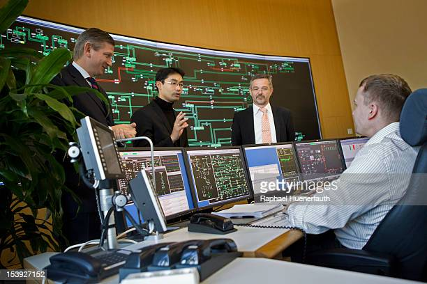 German Economy Minister Philipp Roesler visits the control room of 50Hertz with Boris Schucht CEO and Gunter Scheibner head of network accounting on...
