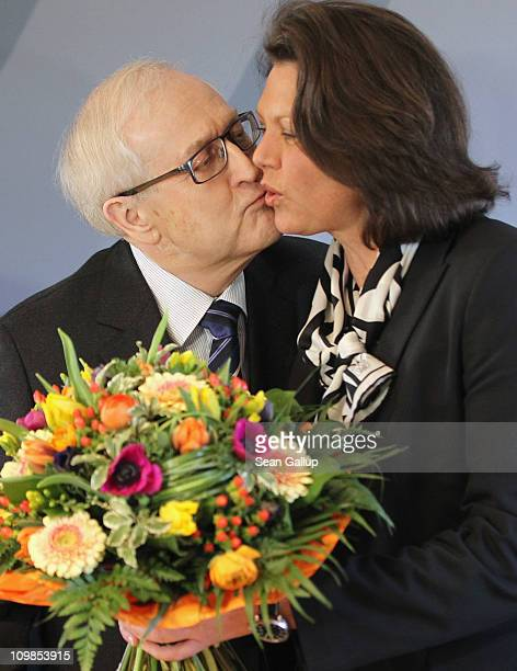 German Economy Minister Rainer Bruederle kisses Agriculture and Consumer Protection Minister Ilse Aigner after giving her flowers on International...