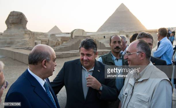 German economy minister Sigmar Gabriel talks to Egypt's tourism minister Mohamed Yehia Rashed and Tarek Tawfiq director of the Grand Egyptian...