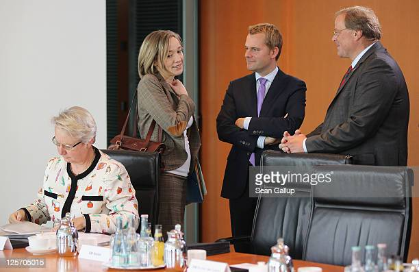 German Education Minister Annette Schavan Family Minister Kristina Schroeder Health Minister Daniel Bahr and Development Minister Dirk Niebel arrive...