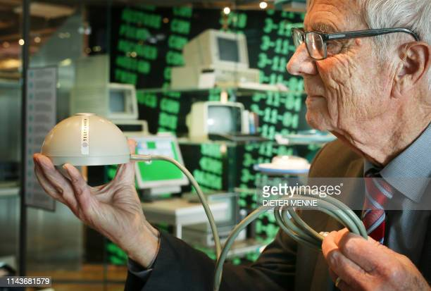 German electrical engineer Rainer Mallebrein holds a ballbased computer mouse invented by him for Telefunken on May 14 2019 in Paderborn northwestern...
