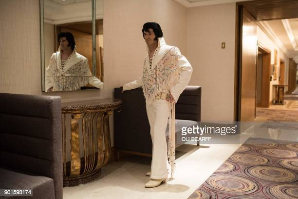 TOPSHOT German Elvis Presley tribute artist Rami poses for a photograph before taking part in the European Elvis Championships at the Hilton...