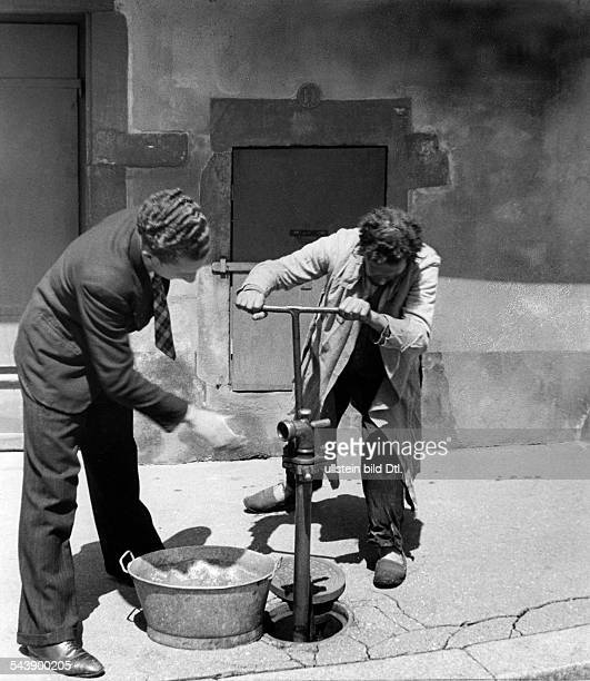 German Empire AlsaceLorraine imperial territory Strasbourg in Second World War under german occupation remigrants are tapping a hydrant on the street...