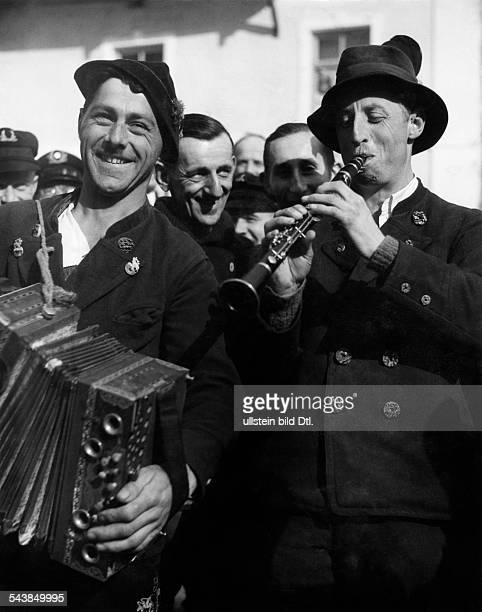 German Empire Bavaria Free State : Kraft durch Freude: two musicians playing accordion and clrainet - Photographer: Max Ehlert- 1934Vintage property...