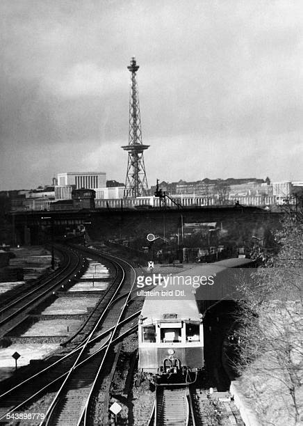 German Empire Berlin Suburban train with Funkturm in the background Photographer Curt Ullmann Published by 'Hier Berlin' 08/1938Vintage property of...