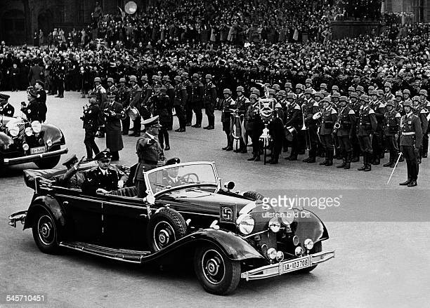 German Empire celebrating the 1st of May Hitler arriving in a Mercedes car for the main manifestaion in the Berlin Lustgarten in the back of the car...