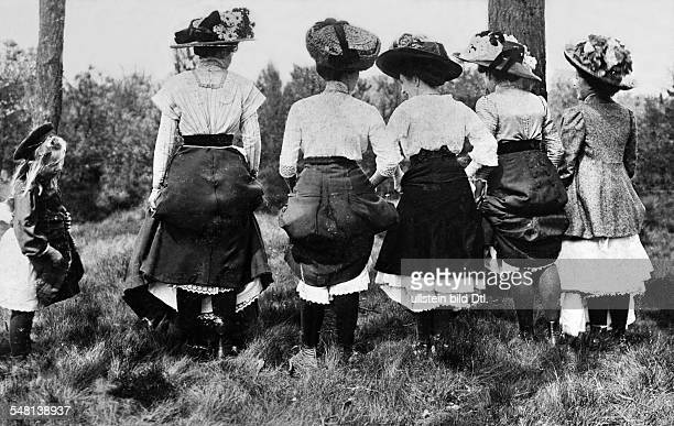 German Empire Excursion at Pentecost Women lift their skirts so you can sneak a peek at their calves Published by 'Tempo' Vintage property of...