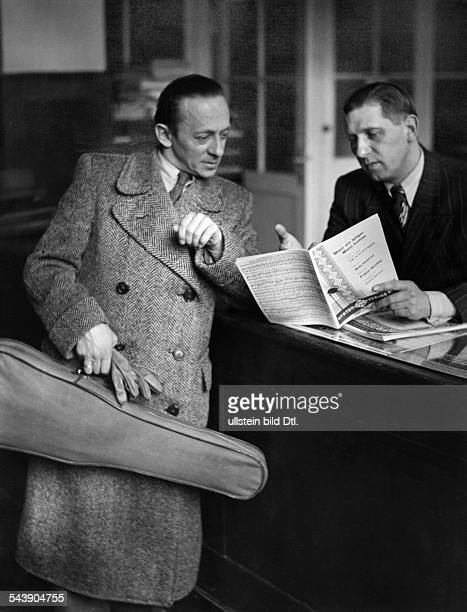 German Empire Free State Prussia Brandenburg Province Berlin Violinist and bandmaster Valentin Marzell reading new sheet music for his orchestra of...
