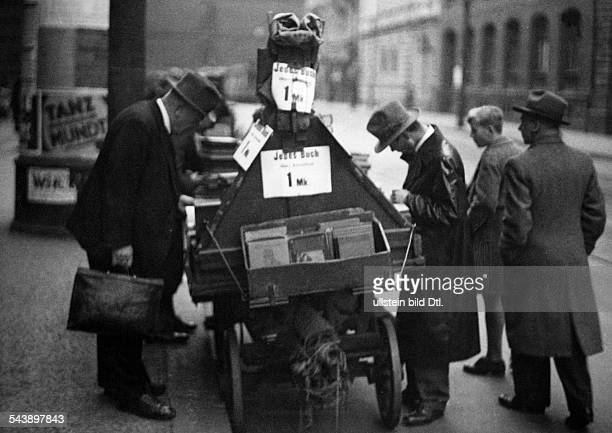 German Empire Free State Prussia Brandenburg Province Berlin 'Book cart' on the street Photographer Curt Ullmann Published by 'Sieben Tage'...