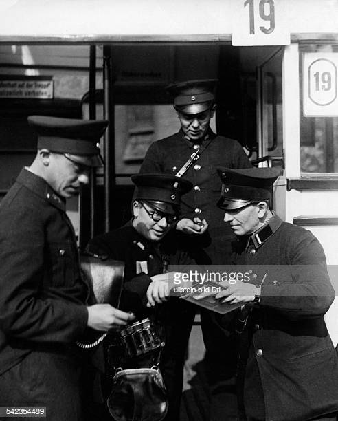 German Empire Free State Prussia Brandenburg Province Berlin Bus conductors are synchronizing their watches Photographer Ullmann Published by 'Hier...